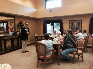 President Bobby Dunn speaks to families and residents about Guardian Pharmacy of NWFL during a family night program at Superior Residences of Niceville, Florida.